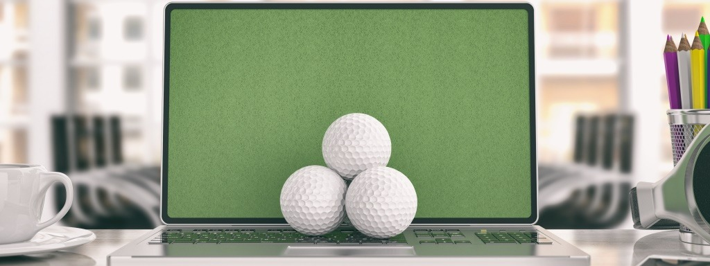 Golf balls on a laptop